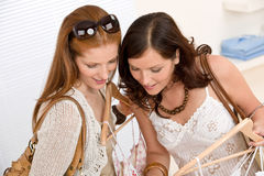 Fashion shopping - Two woman choose sale clothes Stock Photo