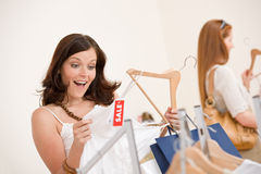 Fashion shopping -  Two woman choose sale clothes. Fashion shopping -  Two happy young woman choose clothes in shop Royalty Free Stock Photography