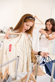 Fashion shopping -  Two young woman choose clothes Royalty Free Stock Image