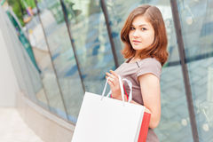 Fashion shopping woman with a white bag outdoor Royalty Free Stock Photos