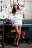 Fashion shot in auto repair shop. Stock Images