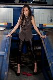 Fashion shot in auto repair shop. Royalty Free Stock Photo