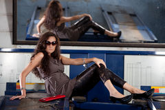 Fashion shot in auto repair shop. Stock Photos
