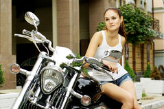 Fashion shot of beautiful model on a motorbike Stock Photos