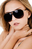 Fashion shot of a beautiful women with sunglasses royalty free stock photography