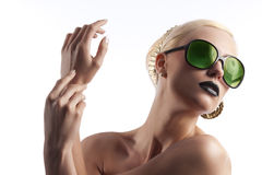 Fashion shot of blond girl with green sunglasses Stock Image