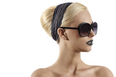 Fashion shot of blond girl with sunglasses Stock Photos