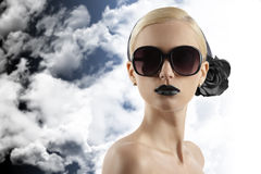 Fashion shot of blond girl with sunglasses looking Stock Image