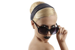 Fashion shot of blond girl with sunglasses posing Stock Photo