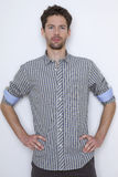 Fashion shot of an elegant young man wearing shirt Royalty Free Stock Photography
