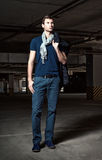 Fashion shot: handsome young man in underground parking Stock Image