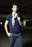 Fashion shot: handsome young man wearing shirt, scarf and jeans Stock Photo