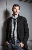 Fashion shot: portrait of a handsome young man wearing jeans and coat Stock Image