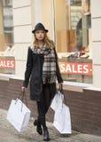 Fashion shot of pretty girl walking on street Stock Photos