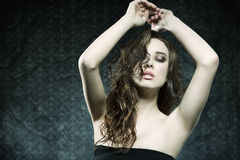 Fashion shot of sensual girl with wavy hair Royalty Free Stock Images