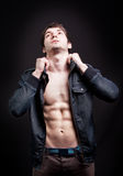 Fashion shot of sexy man with fit abs Royalty Free Stock Photography