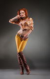 Fashion shot of sexy redhead woman Stock Images