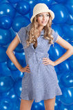 Fashion shot of summer girl in blue, she has both Royalty Free Stock Photo