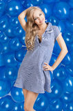 Fashion shot of summer girl in blue, she has both Royalty Free Stock Image