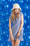 Fashion shot of summer girl in blue, she smiles Stock Photo