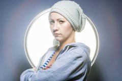 Fashion Shot of Thinking Caucasian Blond Female in Warm Hat and Royalty Free Stock Photography