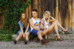 Fashion shot of a trendy group. Of young people royalty free stock photo
