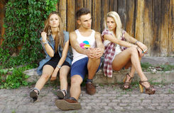 Fashion shot of a trendy of young people Royalty Free Stock Images