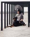 Fashion shot of a woman with black dog royalty free stock image