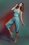 Fashion shot of a woman in blue costume Stock Image