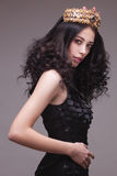 Fashion shot of a woman with diadem in black dress Stock Photo