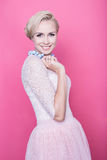 Fashion shot of young beautiful woman with gorgeous cream colored dress Royalty Free Stock Image