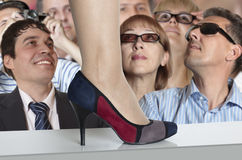 Fashion show. Spectators on demonstration of fashionable footwear stock photos
