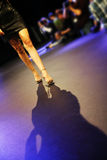 Fashion show. Woman walking down the catwalk at the fashion show Royalty Free Stock Photo