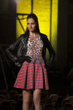 Fashion show beutifull  model with checkered skirt and shirt spotted leopard Royalty Free Stock Images