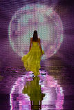 Fashion show catwalk model. A catwalk model walking away from the stage featuring reflection light globe Royalty Free Stock Photo