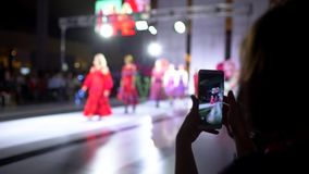 Fashion show. Fashion podium, female model women girls in stylish dresses of designer walking on runway before audience. Viewers at defile show. Fashion catwalk stock video