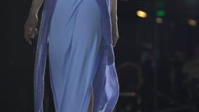 Fashion show. Fashion podium, unrecognizable female model women girls in stylish dresses of designer walking on runway