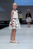 Fashion show. Kids, girl on  podium. Royalty Free Stock Image