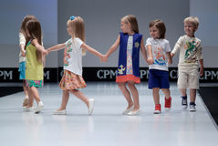 Fashion show. Kids on podium. Royalty Free Stock Photos