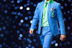Fashion show runway beautiful blue suit. A male model walks the runway in beautiful blue suit during a Fashion Show. Fashion catwalk event showing new collection stock photos