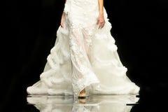 Fashion show runway beautiful wedding dress. A female model walks the runway in beautiful stylish white wedding dress during a Fashion Show. Fashion catwalk Stock Photos