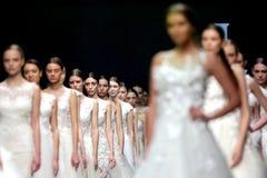 Fashion show runway beautiful wedding dresses. Sofia, Bulgaria - 23 March 2017: Female models walk the runway in beautiful stylish white wedding dresses during a stock image