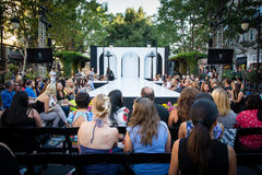 Fashion Show Runway. People mingling and waiting patiently for a fashion show to start Royalty Free Stock Photography