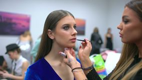 Fashion show, visagist working, making professional make up, backstage. beautiful face of female girl model. Make up. Artist applying stylish makeup to young stock video