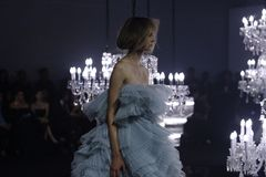 Fashion Show of Wedding dress and Evening Gown along Chandelier. Bangkok, Thailand - October 4, 2018 ; Model walks in Fashion Show of Wedding dress and Evening stock photography