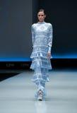Fashion show.Woman on  podium. Royalty Free Stock Photo