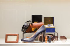 Fashion showcase. Display shoes, bags, watches, sunglasses Royalty Free Stock Photography