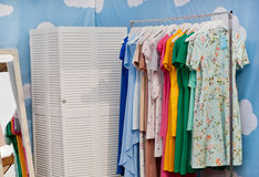 Fashion showroom of designers clothes shop with dresses on hangers. Stock Images