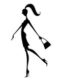 Fashion Silhouette of a Girl Walking in High Heels Royalty Free Stock Photos
