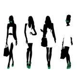 Fashion Silhouettes. 4 fashion silhouettes of women Royalty Free Stock Photos